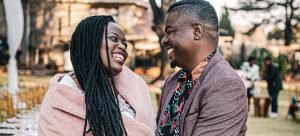 Woman and man smiling at each other at outdoor event