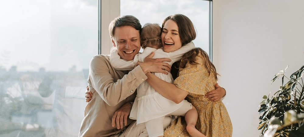 Happy family hugging