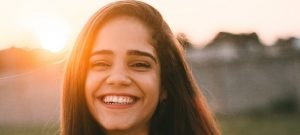 Photo of girl smiling during golden hour