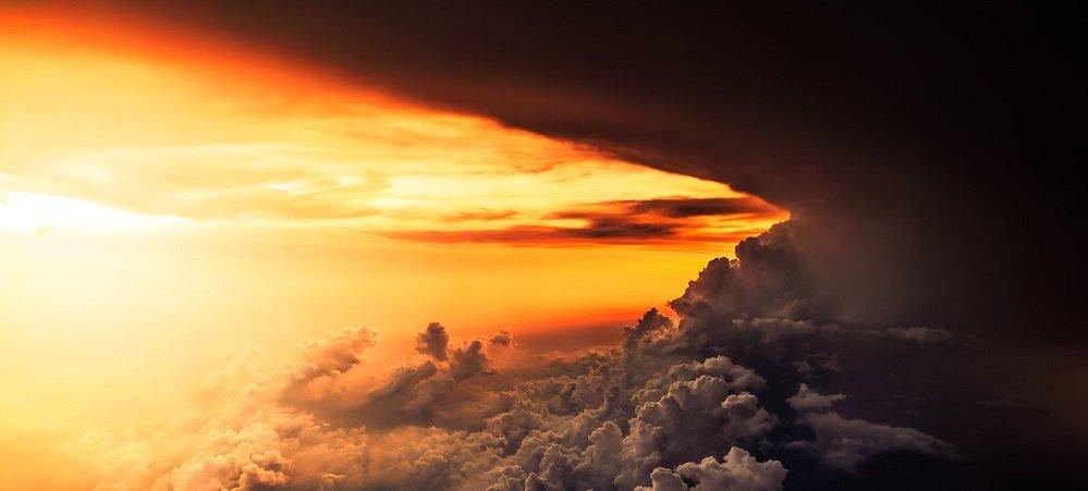 sunlight behind a large dark storm cloud
